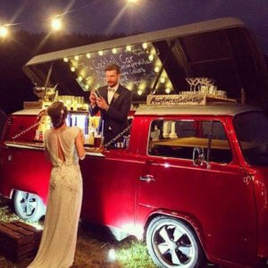 Bride and Groom using a VW Camper as a Cocktail Bar