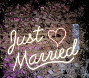 """Neon sign reading """"Just Married"""""""